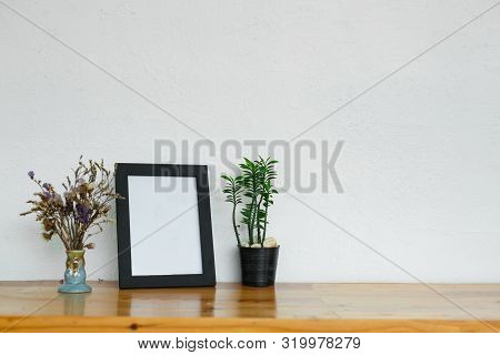 Soft Home Decor, Vase With Green Small Flowers On A White Vintage Wall Background.