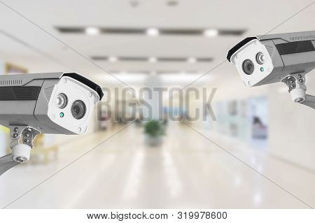 Cctv Security Camera Operating In Hospital On Blur Background.