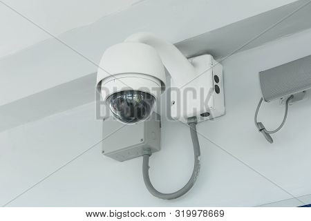 Modern Cctv Camera On A Wall In The Airport.