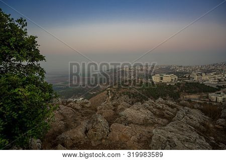 Morning View At Morning Sunrice From Mount Precipice On Nazareth City And A Nearby Valley Near Nazar