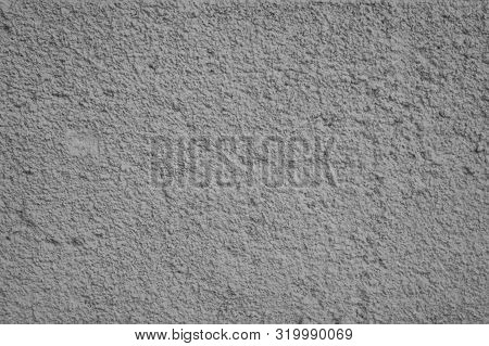 Gritty Texture Of A White Concrete Wall. Decorative Plaster On The Outside Of The Building. Design E