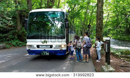 Take The Jr Bus Tohoku Toward Oirase Stream. Famous And Popular Destinations For Flowing River, Gree