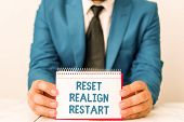 Word writing text Reset Realign Restart. Business concept for Life audit will help you put things in perspectives Man holds empty paper with copy space in front of him Space. poster