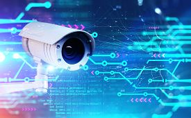 Modern Cctv Camera With Double Exposure Of Circuit Interface, Network And Lines Of Code. Concept Of