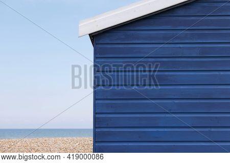 Dark Blue Beach Hut With Copy Space Horizon And Beach Visible
