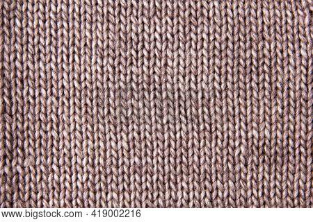 Closeup Of Merino Wool Handmade Knitted Fabric Texture.