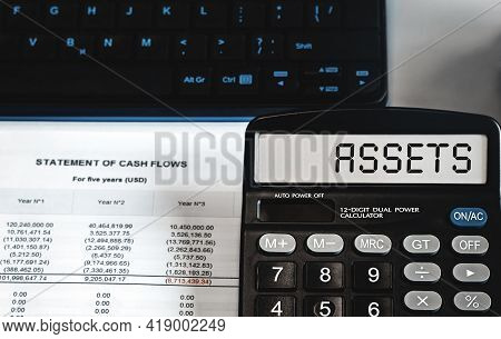 Assets - Concept Of Text On Calculator Display. Business, Tax And Financial Concept