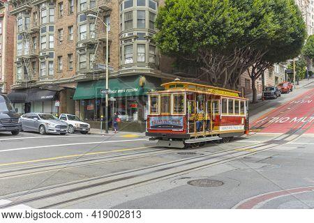 San Francisco,california, Usa - April 20, 2018 : Passengers Enjoy A Ride On A Cable Car On April 20,
