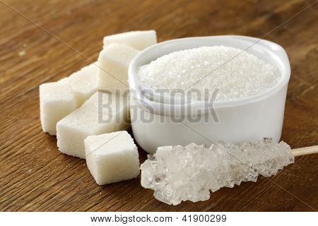 Several types of white sugar - refined sugar and granulated sugar