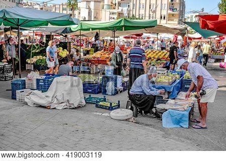 Alanya, Turkey - October 23, 2020: Street Vegetable Market In Alanya. Customers Stroll Among The Tab