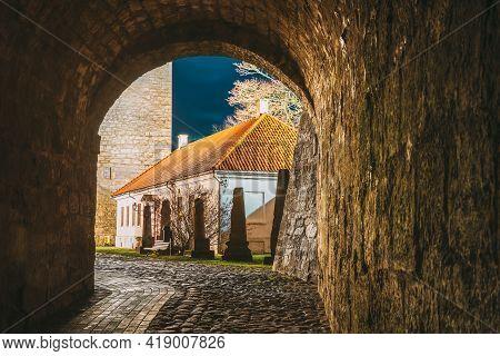 Kuressaare, Saaremaa Island, Estonia. Passage Entrance To Episcopal Castle. Traditional Medieval Arc