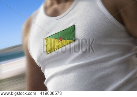 The National Flag Of French Guiana On The Athletes Chest