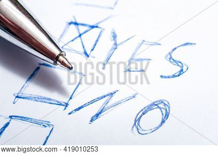 A Voted Yes On A Handwritten Ballot With A Pen Lying On It - Every Vote Counts Concept