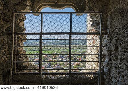View Through A Barred Window, Beckov, Slovak Republic, Europe. Travel Destination.