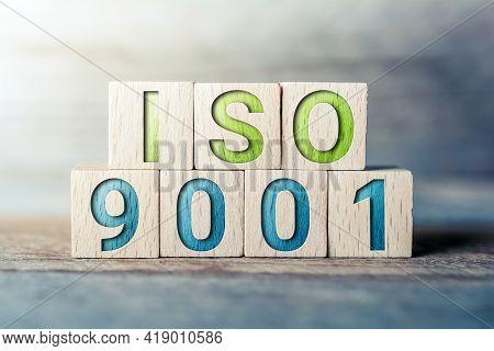 Iso 9001 Written On Wooden Blocks On A Board