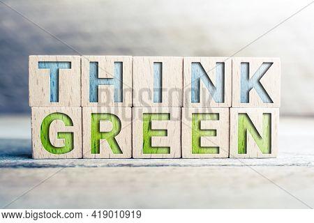 Think Green Written On Wooden Blocks On A Board
