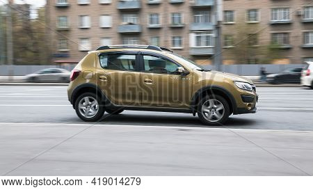 Side View Rolling Shot With Dacia Sandero Stepway Subcompact Car. Fast Moving Brown Small Hatchback