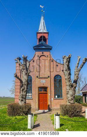 Den Horn, Netherlands - April 20, 2021: Front Facade Of The Historic Church Of Den Horn, Netherlands