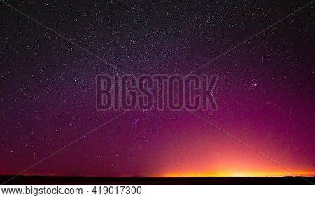 Night Sky Glowing Stars Background Backdrop. Colorful Sky Gradient. Sunset, Sunrise Lights And Colou