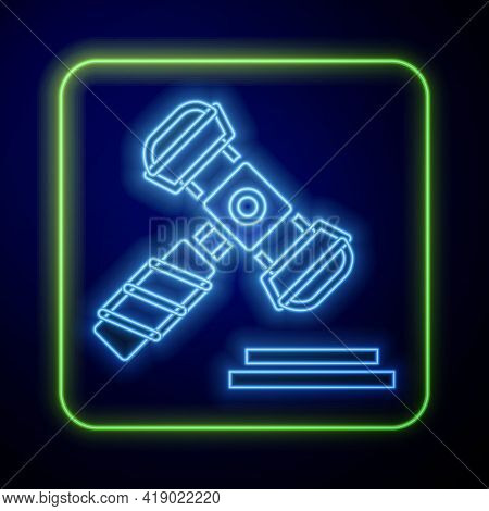 Glowing Neon Judge Gavel Icon Isolated On Blue Background. Gavel For Adjudication Of Sentences And B