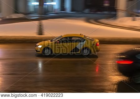 Fast Moving Yandex Taxi Car With Motion Blur Effect. Overspeed Concept. Motion City Street Scene Wit