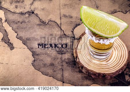 Glass Of Tequila With Map Of Mexico In The Background, Image To Celebrate Tequila Day