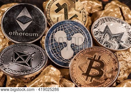 Bitcoin Cryptocurrency And Altcoins With Gold Nuggets. Investment And Store Of Value Concept.