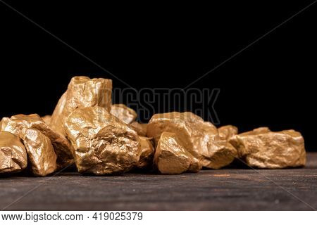 Gold Nuggets On A Black Background, Closeup.