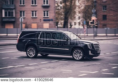 Black Cadillac Escalade Esv Car Moving On The Street On High Speed. Fast Moving Black Suv Car On The