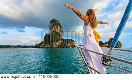 Joyful Young Woman Portrait. Happy Girl Stand On Deck Of Sailing Yacht, Have Fun Discovering Islands