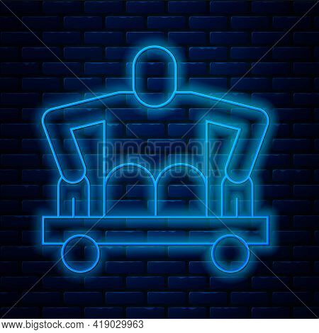 Glowing Neon Line Man Without Legs Sitting Wheelchair Icon Isolated On Brick Wall Background. Disabi