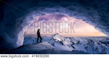 Magical Fantasy Adventre Composite Of Man Hiking In An Ice Cave With Winter Mountain Landscape. Colo