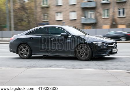 Mercedes-benz Cla At High Speed. A Black Car Drives Fast Through The City With Motion Blur Effect. E