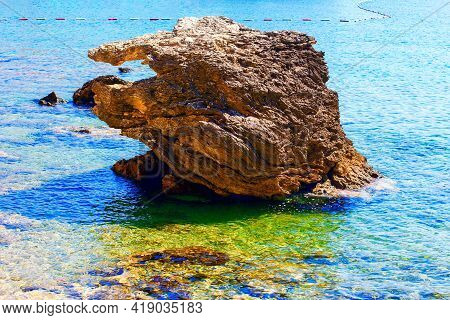 Coastal Rock In The Sea Water . Exotic Beach In The Summer