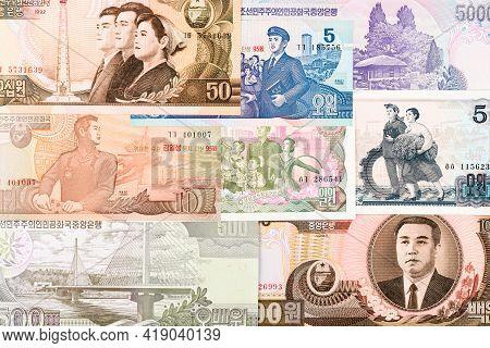 North Korea Won Banknotes Background. High Resolution Vintage Photo Of North Korean Bill 5, Dprk Mon