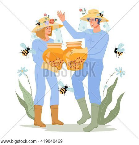 Beekeepers Or Hivers Man And Woman With Jars Of Bee Honey. Extraction Of Honey And Beekeeping. Famil