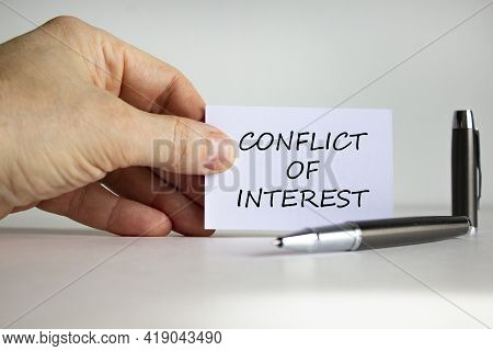 Conflict Of Interest Symbol. White Paper With Words 'conflict Of Interest' In Businessman Hand, Meta