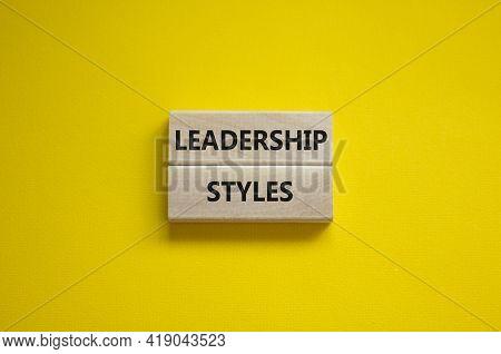 Leadership Styles Symbol. Wooden Blocks With Words 'leadership Styles' On Beautiful Yellow Backgroun