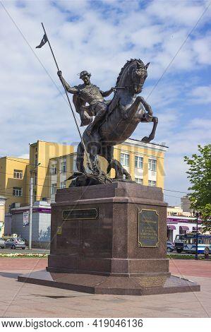 Ivanovo, Russia - Jul 16, 2013: Equestrian Statue Of St. George, Hitting Dragon, On Square In Ivanov