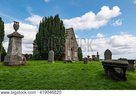 Kinross, Scotland - August 12, 2019: Small Chappel Near Kinross Town And Loch Leven With A Graveyard