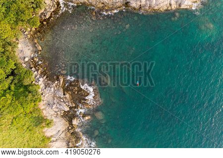 Amazing Aerial View Of Seashore Cliffs Sunset In Phuket Island. Aerial Seascape With Kayak Boat In C