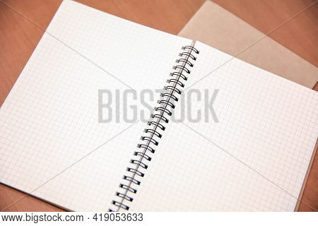 Close-up Blank Notebook Or Note Book Diary On Top View Desk Or Boardroom Table For Meeting Notes.