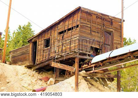 Vintage Wooden Mill On An Abandoned Mining Site Surrounded By An Alpine Coniferous Forest Taken At T