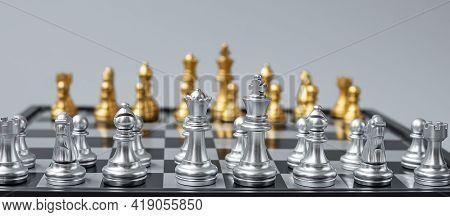 Silver Chess Figure Team (king, Queen, Bishop, Knight, Rook And Pawn) On Chessboard Against Opponent