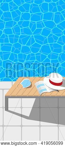Swimming Pool Water And Chaise Longue With A Book, A Hat And A Face Mask On It. Pandemic Summer Conc