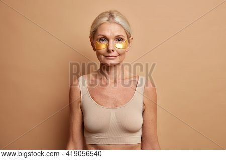 Women Beauty Skin Care And Personal Care Concept. Serious Middle Aged Woman With Blonde Combed Hair
