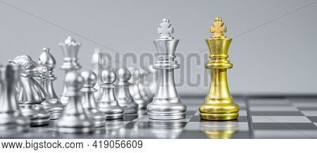 Gold And Silver Chess King Fgure On Chessboard Against Opponent Or Enemy. Strategy, Conflict, Manage