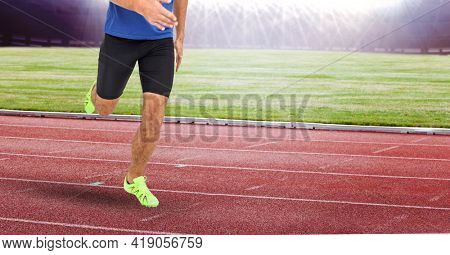Composition of low section of male athlete running on track in sports stadium. sport and competition concept digitally generated image.