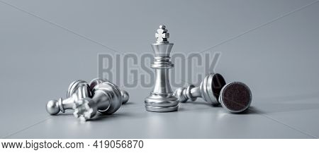 Chess King Figure Stand Out From Crowd Of Enermy Or Opponent During Chessboard Competition. Strategy