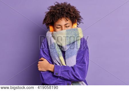 Curly Ethnic Teenage Girl Tries To Warm Herself As Walks During Cold Weather Wears Jacket And Warm S
